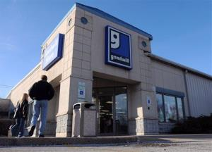 Pedestrians walk past the Goodwill store in Moline, Ill., on Wednesday, Nov. 30, 2011.