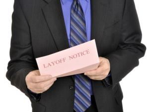 A stock photo of a man receiving a layoff notice.