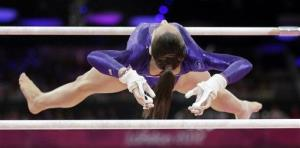 US gymnast Jordyn Wieber performs on the uneven bars during the women's qualification at the 2012 Summer Olympics, Sunday, July 29, 2012.