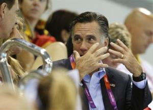 Mitt Romney, right, speaks with an unidentified person during swimming heats at the Aquatics Centre in the Olympic Park during the 2012 Summer Olympics in London, Saturday, July 28, 2012.