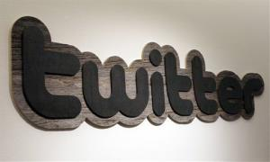 In this June 23, 2010 file photo, a Twitter sign hangs at the offices of Twitter Inc., in San Francisco.
