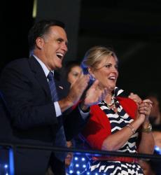 Mitt Romney, left, and his wife Ann applaud as the USA team enters the stadium during the Opening Ceremony at the 2012 Summer Olympics, Friday, July 27, 2012, in London.