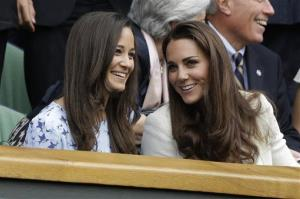 Kate, Duchess of Cambridge, right, speaks with her sister Pippa Middleton as they arrive to the men's final match at the All England Lawn Tennis Championships at Wimbledon, England, July 8, 2012.