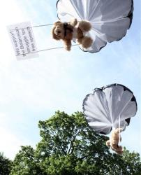 In this undated photo provided by Studio Total, teddy bears hang on parachutes during training in Stockholm, Sweden.