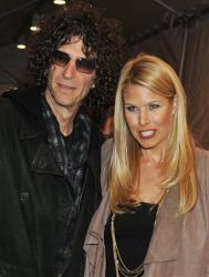Howard Stern and his wife, Beth Ostrosky, arrive for the first-ever concert by Paul McCartney at Harlem's Apollo Theater, Dec. 13, 2010, in New York.