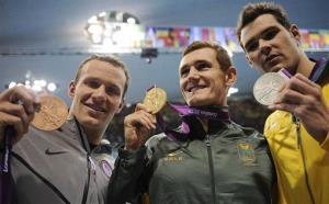 Brendan Hansen, Cameron van der Burgh, and Christian Sprenger pose with their medals for the men's 100-meter breaststroke swimming final during the 2012 Summer Olympics in London, July 29, 2012.
