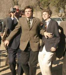 FILE - In this undated publicity photo originally released by Fox, Jason bateman, center, and Michael Cera, right, are shown in a scene from the TV series Arrested Development.