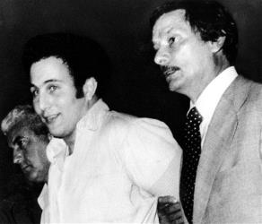 In this Aug. 11, 1977 file photo, David Berkowitz, center, is taken into police headquarters by New York Police Department detective Ed Zigo, right.