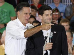 Mitt Romney points to a supporter in the crowd as his running mate, Rep. Paul Ryan, R-Wis. looks on during a rally at Randolph-Macon College in Ashland, Va., Saturday, Aug. 11, 2012.