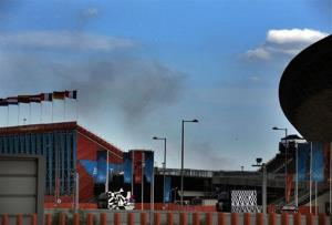 Smoke rises from a fire at a recycling center on Chequers Lane in Dagenham, east London, behind the Olympic Park's BMX track on Sunday, Aug. 12, 2012.