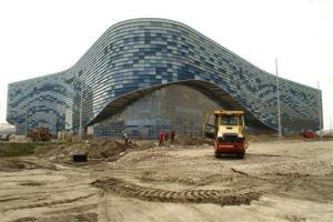 In this photo taken Thursday, Aug. 9, 2012, the Maly Ice Palace is under construction at the Olympic Park which is under construction in the Black Sea resort of Sochi, southern Russia.