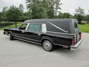 The driver apparently died while taking the casket to a funeral.