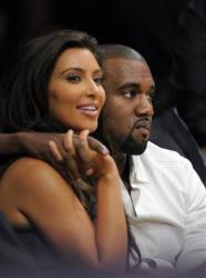 Kim Kardashian and Kanye West watch the Los Angeles Lakers play the Denver Nuggets Saturday, May 12, 2012, in Los Angeles.
