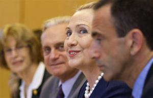 Surrounded by diplomats and staff, Hillary Rodham Clinton meets with Turkey's Foreign Minister Ahmet Davutoglu, not pictured, in Istanbul, on Saturday, Aug. 11, 2012.
