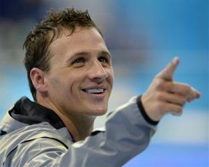 Ryan Lochte gestures after receiving his silver medal for the men's 200-meter IM swimming final at the Aquatics Centre in the Olympic Park during the 2012 Summer Olympics in London, Aug. 2, 2012.