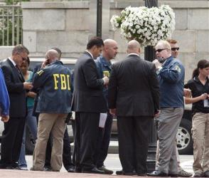 Washington police and FBI agents gather outside the Family Research Council in Washington.