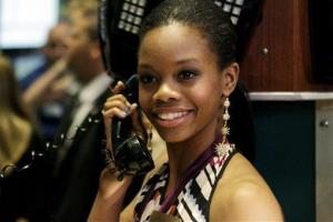 Olympic champion gymnast Gabby Douglas pretends to talk on the phone while posing for photos on the floor of the New York Stock Exchange on Aug. 14.