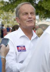 Conservative GOP Rep. Todd Akin talks with a reporter at the Missouri State Fair in Sedalia, Mo., last week.