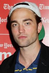A subdued Robert Pattinson turns up in Manhattan to plug his new film 'Cosmopolis.'