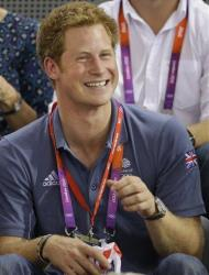 Britain's Prince Harry watches track cycling during the 2012 Summer Olympics.