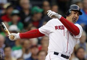 Boston Red Sox's Adrian Gonzalez follows through on a two-run double in the first inning of a baseball game against the Baltimore Orioles in Boston, Thursday, June 7, 2012. The Red Sox won 7-0.