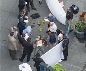 Officials examine the body of gunman Jeffrey Johnson, who was killed by police after fatally shooting former co-worker Steven Ercolino outside the Empire State Building, Aug. 24, 2012, in New York.
