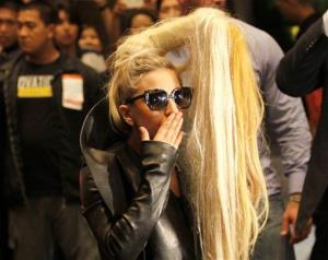 In this May 19, 2012 file photo, American pop singer Lady Gaga blows a kiss upon her arrival in a hotel in Manila's financial district of Makati, Philippines.