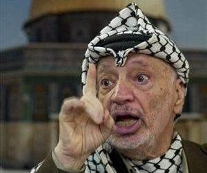 In this Dec. 24, 2002 file photo, Palestinian leader Yasser Arafat talks to the media during a press conference at his headquarters, in the West Bank town of Ramallah.