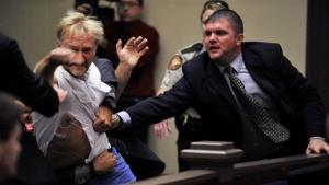 Wesley Thomas, the stepfather of victim Tiffany York, is tackled by courtroom security during the hearing of Sgt. Anthony Peden at Long County Superior Court, Thursday Aug. 30, 2012, in Ludowici, Ga.