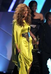 Beyonce accepts the award for best female R& B at the BET Awards on Sunday, July 1, 2012, in Los Angeles.