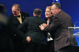 Parti Quebecois Leader Pauline Marois was whisked off stage as she delivered her victory speech.