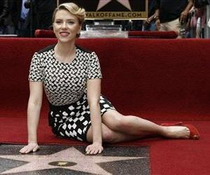 Actress Scarlett Johansson poses for photographers after receiving a star on the Hollywood Walk of Fame in Los Angeles, May 2, 2012.