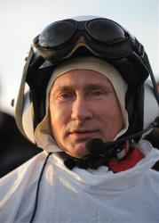 Vladimir Putin prepares for a flight in a motorized hang glider, on the Yamal Peninsula, Wednesday, Sept. 5, 2012.