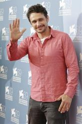 Actor James Franco poses during the photo call of the movie 'Spring Breakers' at the 69th edition of the Venice Film Festival in Venice, Italy, Wednesday, Sept. 5, 2012.