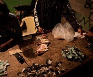 In this Aug.  8, 2012 photo, traffickers sell drugs in the Antares slum in Rio de Janeiro, Brazil.