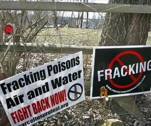 In this Thursday, Feb. 23, 2012 file photo, signs opposing the hydraulic fracturing process of drilling for gas, or fracking  are posted at the front of the yard of Janet McIntyre 's Evans City, Pa.