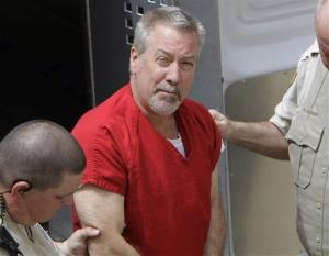 In this May 8, 2009 file photo, former Bolingbrook, Ill., police sergeant Drew Peterson arrives at the Will County Courthouse in Joliet, Ill.