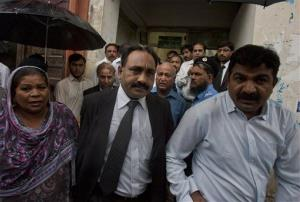 Tahir Naveed Chaudhry, center, lawyer of Christian girl accused of blasphemy, leaves after court hearing in Islamabad, Pakistan on Monday, Sept. 3, 2012.
