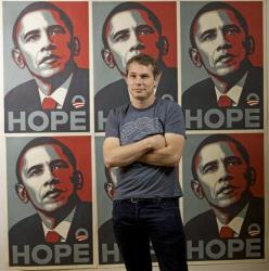 Artist Shepard Fairey poses in front of his Barack Obama poster.