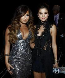 Demi Lovato, left, and Selena Gomez arrive at the MTV Video Music Awards on Sunday Aug. 28, 2011, in Los Angeles.