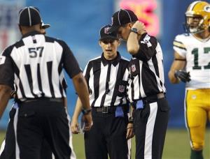 Shannon Eastin, center, works with fellow officials during an NFL preseason football game between the San Diego Chargers and the Green Bay Packers, Thursday, Aug. 9, 2012, in San Diego.