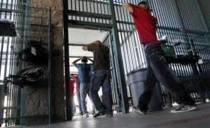 Illegal immigrants prepare to enter a bus after being processed at Tucson Sector U.S. Border Patrol Headquarters Thursday, Aug. 9, 2012, in Tucson, Ariz.