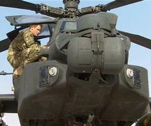 Prince Harry climbs onto an Apache helicopter at Camp Bastion in Afghanistan, Sept. 7, 2012.