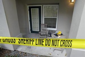 This photo taken Wednesday, Dec. 1, 2010, shows the crime scene at a condominium in Celebration, Fla.