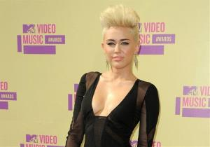 In this Sept. 6, 2012, file photo, Miley Cyrus attends the MTV Video Music Awards in Los Angeles.
