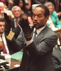 OJ Simpson holds up his hands before the jury in his 1995 murder trial after putting on a pair of gloves similar to the infamous bloody gloves.
