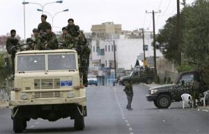 Yemeni soldiers patrol the street in front of the US Embassy in Sana'a.