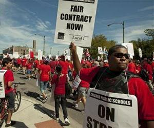A large group of public school teachers seek support from neighborhood communities as they march on streets surrounding John Marshall Metropolitan High School, Sept. 12, 2012 in West Chicago.