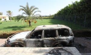 A burnt car sits in front of  US consulate in Benghazi, Libya.