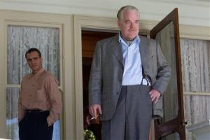 This film image shows Joaquin Phoenix, left, and Philip Seymour Hoffman in a scene from The Master.
